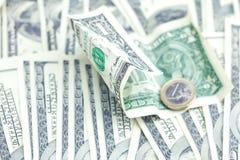 против евро одного доллара монетки Стоковое Изображение