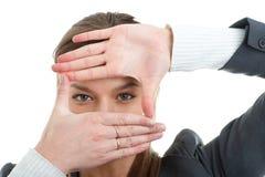 против коммерсантки предпосылки gesturing белизна Стоковые Изображения RF