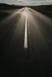 против солнца пустой дороги прямого Стоковые Фото