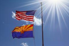против флагов летая светя солнце Стоковая Фотография