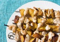 протыкальники персиков цыпленка Стоковое Фото