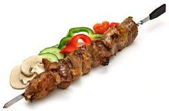 Протыкальник с shish-kebab и овощами Стоковая Фотография
