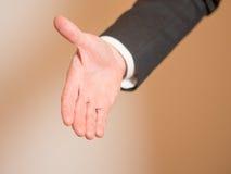 Протягиванная рука, который нужно приветствовать Стоковые Изображения