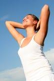 протягивать женщину солнечного света Стоковая Фотография
