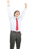 Протягивать утомленного испанского работника офиса зевая Стоковая Фотография