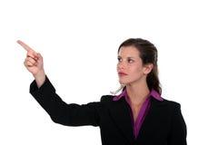 Профессионал указывая ее указательный палец стоковая фотография rf
