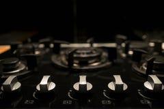 Профессиональная черная плита кухни стоковое фото