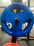 Профессиональный олимпийский диск для штанги Стоковая Фотография RF