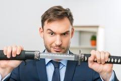 Профессиональный работник офиса держа шпагу Стоковая Фотография RF