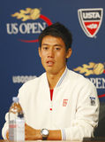 Профессиональный теннисист Kei Nishikori во время пресс-конференции после того как он выиграл спичку полуфинала на США раскрывает Стоковое Изображение RF