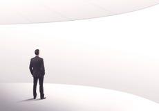 Продавец стоя с его задней концепцией Стоковое Изображение