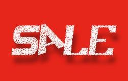 Продажа знамени Белые письма на красной предпосылке Стоковые Фото