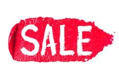 Продажа надписи написана на ходе губной помады на белизне Стоковые Изображения RF