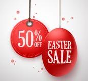 Продажа пасхи в красном яичке с 50% с смертной казни через повешение ценника в белой предпосылке Стоковая Фотография