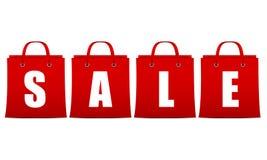 Продажа подписывает внутри красный цвет в форме пакетов с белизной Стоковое Изображение