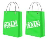 Продажа подписывает на зеленых сумках kraft ходя по магазинам бумажных Стоковые Фотографии RF