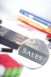 Продажи формулируют сфокусированный лупой Стоковая Фотография RF