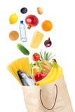 Продуктовая сумка и падая здоровая еда Стоковое Изображение RF