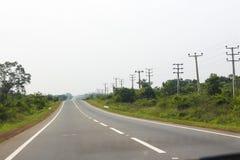 Прямо чистая длинная дорога отключения стоковая фотография rf