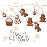 Пряники рождества вися на шариках бесплатная иллюстрация