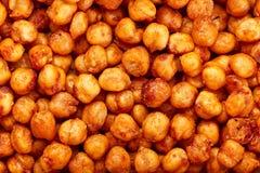 Пряные испеченные нуты Moreish закуска vegan, приправленная с копчеными паприкой, тимоном и кориандром Стоковая Фотография