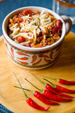 Пряный Chili с фасолями, томатами и тайскими перцами Стоковые Фото