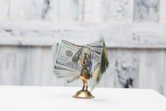 Птица денег на таблице Стоковые Изображения