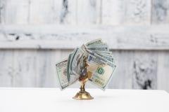 Птица денег на таблице Стоковое Фото
