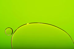 Пузыри на зеленой абстрактной предпосылке Стоковое Изображение