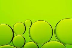 Пузыри на зеленой абстрактной предпосылке Стоковая Фотография
