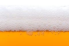 пузыри пива закрывают стеклянную съемку вверх Стоковое фото RF