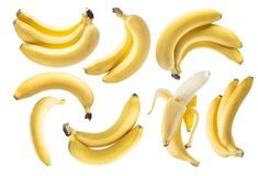 Пуки банана на белой предпосылке Стоковые Изображения RF