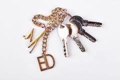 Пук ключей на белой предпосылке Стоковые Фотографии RF
