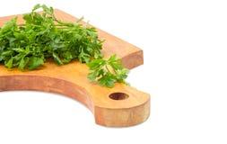 Пук петрушки на деревянной разделочной доске Стоковая Фотография