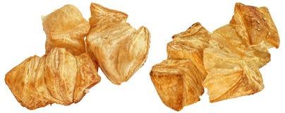 Пук свеже испеченного печенья слойки сезама квадрата Zu-Zu изолированного на белой предпосылке Стоковые Изображения RF