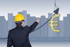 Пункты бизнесмена к евро Стоковое фото RF