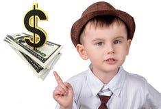 Пункты мальчика на долларах и знаке доллара Стоковая Фотография