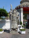 Пункт обслуживания школы массажа Wat Pho тайский Другая привлекательность Wat Pho Китайские каменные статуи украшенные сводами и  стоковые изображения rf