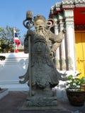 Пункт обслуживания школы массажа Wat Pho тайский Другая привлекательность Wat Pho Китайские каменные статуи украшенные сводами и  стоковое фото rf