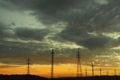 Пунцовые облака на заходе солнца Стоковое Фото