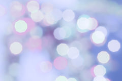 Пурпур покрасил предпосылку праздника конспекта света bokeh рождества Стоковые Изображения RF