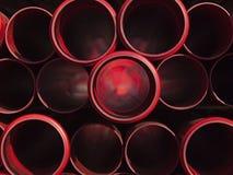 пускает пластичный красный цвет по трубам Стоковое Изображение RF