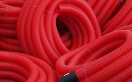 пускает пластичный красный цвет по трубам Стоковое Изображение