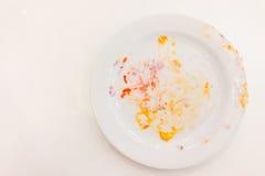 Пустая белая плита с мякишами и сливк Стоковая Фотография