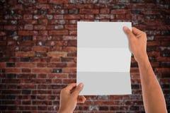 пустая бумага удерживания Стоковое Изображение