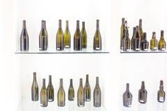 Пустая бутылка вина на белой предпосылке Стоковые Изображения