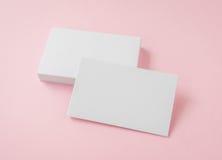 Пустая визитная карточка на розовой предпосылке Стоковое фото RF
