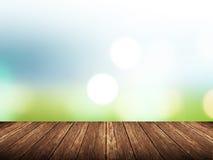Пустая деревянная таблица над запачканной зеленой природой с предпосылкой bokeh Стоковое фото RF
