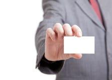 пустая карточка бизнесмена держа вне Стоковое Изображение RF