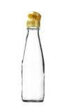 Пустая крышка стеклянной бутылки соуса всплывающая изолированная на белой предпосылке Стоковые Фото